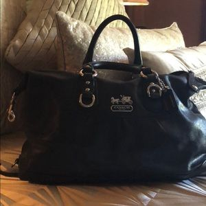 Coach black leather handbag.